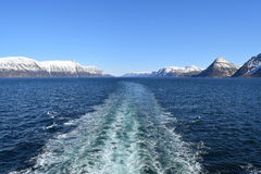 Cruise ship traveling out a Norwegian fjord Stock Image