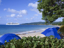 Cruise ship and tropical beach. Scenic view of tropical beach with cruise ship moored in background, Frederiksted, St. Croix, U.S. Virgin Islands Royalty Free Stock Photography