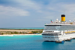 Cruise Ship in Turks and Caicos Islands. Luxury cruise ship anchored in port of Turks and Caicos Islands in the Caribbean Royalty Free Stock Images