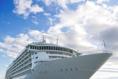 Cruise ship under blue skies Royalty Free Stock Photo