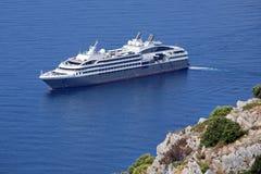 Cruise-ship. Cruise ship under blue sky traveling Stock Images