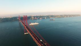 Cruise ship under Bridge Ponte 25 de Abril in Lisbon aerial view stock video