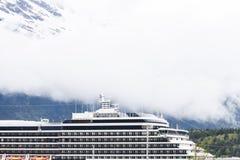 Cruise Ship Under Foggy Mountains Royalty Free Stock Photos