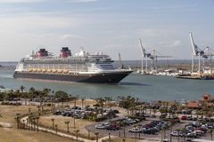 Cruise ship underway. Port Canaveral, Florida, USA. Port Canaveral, Florida, USA. circa 2017. Cruise ship Disney Fantasy departing Port Canaveral stock image