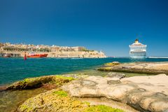 Cruise ship and Valletta harbor view from Birgu. Malta. Cruise ship and Valletta harbor, Malta Stock Image