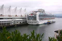Cruise ship in Vancouver BC. A cruise ship is restocked at the Canada place in Vancouver BC before departure Stock Image