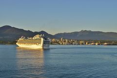 A cruise ship in Vancouver, British Columbia. VANCOUVER, CA -The Crown Princess cruise ship on the water in Burrard Inlet in Vancouver, British Columbia Royalty Free Stock Photo