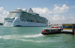 Cruise Ship in Venice. VENICE, ITALY - JUNE 6: The large cruise ship Serenade of the Seas sailing past a vaporetto stop into Venice on June 6 2013.  There have Stock Image