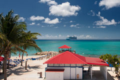 Cruise Ship and Village. Cruise Ship Docked off the coat of a Caribbean Village Stock Images