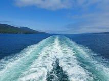 Cruise ship wake in Alaska royalty free stock photos