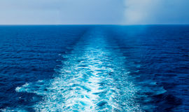 Cruise Ship Wake. Blue water and sky Stock Image