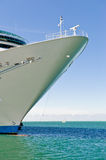 Cruise ship on water. Docked cruise ship bow with blue water and sky Stock Image