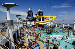 Cruise ship water slide & pools. Passenger enjoy a day at sea on board Norwegian Epic, NCL's newest mega ship Royalty Free Stock Images