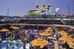 Cruise Ship  - Waterslide and Umbrellas Royalty Free Stock Images