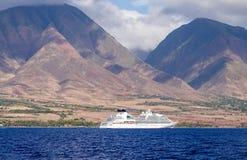 Cruise ship, west maui mountains. A cruise ship plys the blue pacific waters, beneath the west maui mountains, near lahaina, maui, hawaii royalty free stock photo