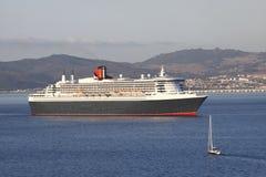 Cruise ship and yacht stock image