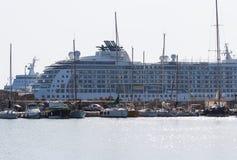 Cruise ship and yacht in bay of Mandraki. Rhodes, Greece. Cruise ship and yacht in the bay of Mandraki. Rhodes, Greece Royalty Free Stock Image