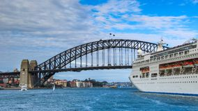 Cruise shipping under the Sydney Harbour Bridge. AUSTRALIA, SYDNEY - MARCH 21, 2014: Large cruise shipping heading towards the Sydney Harbour Bridge Stock Photo