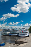 Cruise ships. Several white cruise liners are moored in river port. Saint-Petersburg, Neva river. Blue sky with clouds Stock Photography