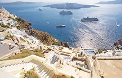 Cruise ships anchor Nea Kumeni the volcanic islet. Stock Photos