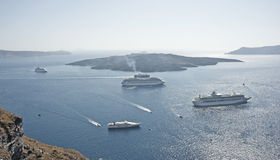 Cruise ships around Nea Kumeni the volcanic islet. Stock Image