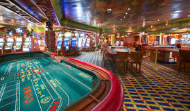 Cruise ships casino. Located on main walking deck 4. 15 tables and 300+ slot machines are available for unforgetable experience Royalty Free Stock Photos