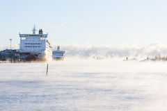 Cruise ships in a cold vaporing sea Royalty Free Stock Photos