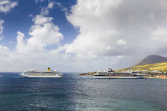 Cruise ships Costa Magica and Celebrity Cruises docked in the port of Basseterre. Basseterre, Saint Kitts and Nevis - January 07, 2016: Cruise ships Costa Magica Royalty Free Stock Photography