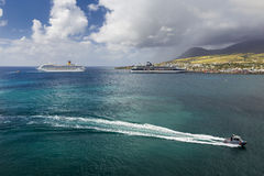 Cruise ships Costa Magica and Celebrity Cruises docked in the port of Basseterre Stock Image