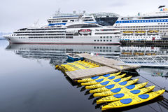 Cruise ships and kayaks in Alesund, Norway Royalty Free Stock Photo