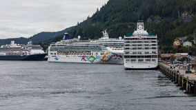 Cruise Ships in Ketchikan. Large cruise ships docked in the harbor at Ketchikan, Alaska stock images