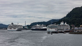 Cruise Ships in Ketchikan. Large cruise ships docked in the harbor at Ketchikan, Alaska royalty free stock image