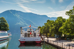 Cruise ships are moored at the pier in Annecy, France Stock Photography
