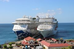 Cruise ships MS Royal Princess and MSC Fantasia in St. George`s, Grenada. Cruise ship MS Royal Princess in St. George`s port, Grenada.  MS Royal Princess is a Stock Photography