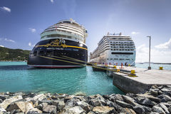 Cruise ships MSC Orchestra and Disney Fantasy docked in the port. Road Town, British Virgin Islands - January 05, 2016: Cruise ships MSC Orchestra and Disney royalty free stock image