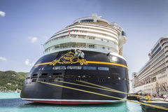Cruise ships MSC Orchestra and Disney Fantasy docked in the port. Road Town, British Virgin Islands - January 05, 2016: Cruise ships MSC Orchestra and Disney Stock Images