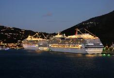 Cruise ships at night. Saint Thomas, US Virgin Islands - December 9, 2008: Two Carnival ships visiting St Thomas at night. The island is one of the most visited Royalty Free Stock Images