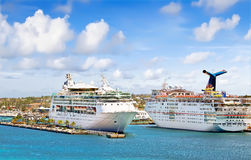 Cruise Ships at port. NASSAU, BAHAMAS - APRIL 13, 2015: Royal Caribbean cruise ship Grandeur of the Seas and Carnival Fascination docked at port on the sunny day Stock Images