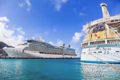 Cruise Ships in port. PHILIPSBURG, ST. MARTEEN - APRIL 16,2015: Cruise ships Celebrity Silhouette and Allure of the Seas, docked at Philipsburg, St. Marteen Stock Photo