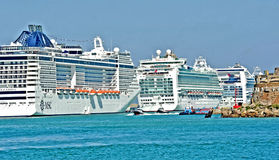 Cruise ships in a row in harbour. Civitavecchia Rome Italy Cruise ships parked in the harbor, first Italian and European route with 2.5 million cruisers and 1000 stock photo