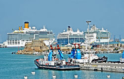 Cruise ships in a row in harbour. Civitavecchia Rome Italy Cruise ships parked in the harbor, first Italian and European route with 2.5 million cruisers and 1000 royalty free stock images