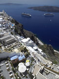 Cruise Ships in Santorini - Greece. Cruise Ships in the Greek Island of Santorini in the Cyclades in the Aegean Sea off the coast of Greece. Viewed from the town royalty free stock photography