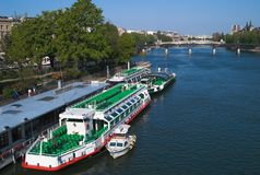 Cruise ships on Seine river. Sightseeing cruise ships on Seine river in expectation of passengers, Paris, France Royalty Free Stock Photos