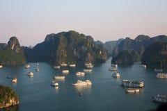 Cruise ships in serene Vietnam`s Halong bay stock photography