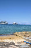 Cruise ships from the shore. Two cruise ships at anchor in a Caribbean bay.  Taken in Grand Cayman Stock Image