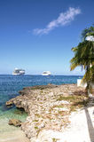 Cruise ships from the shore. Two cruise ships at anchor in a Caribbean bay.  Taken in Grand Cayman Royalty Free Stock Image