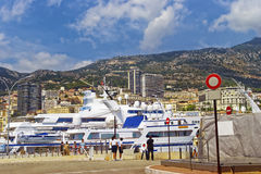 Cruise ships, yachts and personnel in the port Stock Photos