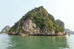 Cruise stop and waiting for tourists at the bay of Dong Thien Cung Cave with in summer at Ha Long Bay. Quang Ninh, Vietnam.  Royalty Free Stock Photos