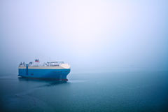 Cruise stops in the sea in a foggy Stock Photography