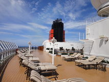 Cruise Sun Deck with nice deck chairs. Sundeck on a cruise ship with deck chairs or sunbeds. Blue sky in the background Stock Photo